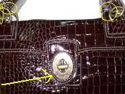 fake coach diaper bag hardware